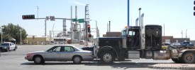 A two-vehicle accident took place Thursday morning at the intersection of First and Main streets. A black semi truck owned by Hanson Trucking Inc. of Roosevelt, Utah, rear-ended a gold Park Avenue Buick just after 10:30 a.m. The Buick was in motion and reportedly stopped abruptly, causing the semi to hit and then propel the Buick further into the lane. The woman driving the Buick suffered back and neck injuries and was placed on a gurney and taken to Artesia General Hospital.    Photo by Grace Miller – Daily Press / Cutline by Rebekah Melendez – Daily Press
