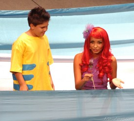 """Ariel shows off a fork she found while swimming near the surface to her fish friend Flounder during the Rising Star Children's Theatre's production of """"The Little Mermaid"""" Saturday evening at the Ocotillo Performing Arts Center. Brienne Green - Daily Press"""