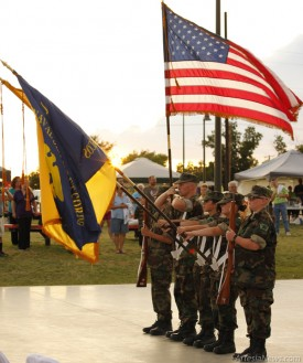 At left, the U.S. Naval Sea Cadets present the colors to open Artesia's National Night Out Tuesday at MLK Jr. Park. Brandon Messick - Daily Press