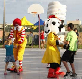 Ronald McDonald, Sparky the Fire Dog and CFL Charlie the light bulb engage youth attending Tuesday's National Night Out event at the Martin Luther King Jr. Recreation Complex during the Mascot Challenge dance-off. Brandon Messick - Daily Press