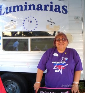 "Liana Swarengin - Daily Press Cancer survivor Shirley Hernandez ""fights like a girl"" while selling luminarias Friday at Artesia's Relay for Life event."
