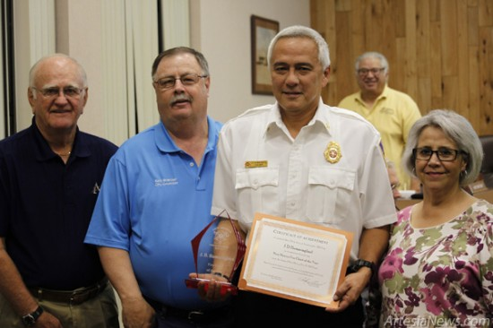 Fire Chief J.D. Hummingbird, second from right, is joined by, from left, Mayor Phil Burch and city councilors Kent Bratcher and Nora Sanchez after being announced to the council as New Mexico's Fire Chief of the Year. Brandon Messick - Daily Press