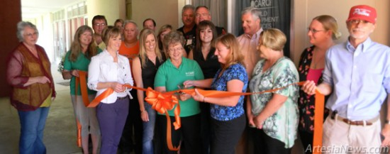 Members of the Artesia Chamber of Commerce and Artesia Trailblazers join staff with CARC Inc. at a ribbon cutting Tuesday in celebration of the Carlsbad-based child development services organization's opening of a branch office in Artesia, located at 315 W. Washington Ave. Grace Miller - Daily Press