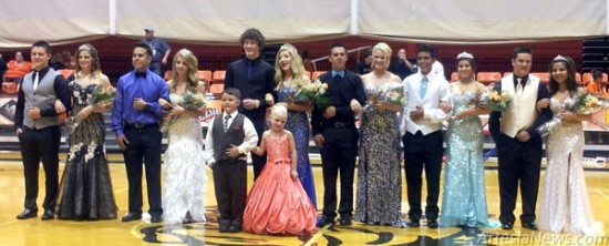 "Grace Miller - Daily Press Richardson crowned Homecoming Queen  The 2013 Artesia High School Homecoming Court poses for the crowd Thursday during the ""Growl"" at Bulldog Pit. They are, from left, escort Decker Reno and Junior Attendant Jordan Montoya; escort Denzyl Garcia and Senior Princess Kaity Butcher; escort Baylor Johnson and Homecoming Queen Morgan Richardson; escort Ashton Gomez and Senoir Princess Madison Casey; escort Christian Rodriguez and Senior Princess Alexandra Aguilar; and escort Cameron Liles and Sophomore Attendant Alexandria Flores. At front are crown bearer and flower girl Jackson Parker and Brooklyn Ivans."