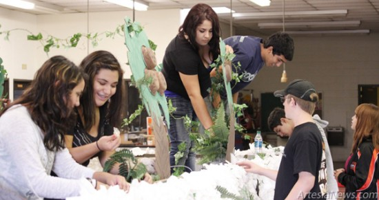 "Artesia High School students Kaylee Flores, Amanda Lovrie, Sadie Soto, JD Runyan, John Vasquez, Katelynn Pinkerton and Jesus Rodriguez put the finishing touches on a Homecoming parade float this week at AHS. Approximately 30 students participated in the float's construction, which will be unveiled at 4 p.m. today during the 2013 Homecoming parade, set to begin at Bulldog Bowl and proceed east on Main Street to Second Street. ""Beat the Jaguars!"" the students said in support of the Bulldogs, who will take on Valencia at 7 p.m. today at Bulldog Bowl. Brandon Messick - Daily Press"