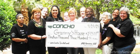 Representatives of Grammy's House and Concho Resources gather as Concho presents the local domestic violence agency with a check for $19,300. Pictured are, from left, representing Grammy's, Frances Arredondo, Pat Wood, Crystal S-Moncha, Celena Bryant and Connie Lewis; Gayle Burleson, vice president of New Mexico for Concho; Ramon Reyes, asset manager of New Mexico shelf operations; and, representing Grammy's, Joyce Lloyd, Martha Spier, Lupe Delerosa and Nancy Jurney. Rebekah Melendez - Daily Press