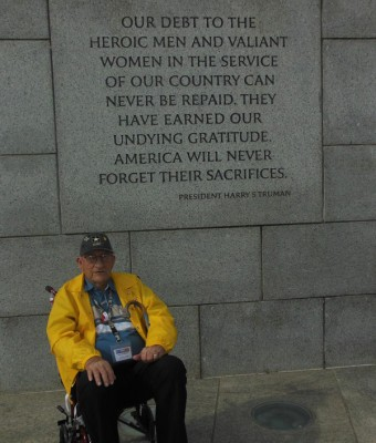 Leonard Witcher sits in front of the Pacific Theatre pillar at the World War II Memorial in Washington, D.C. Courtesy Photo