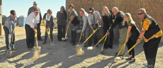 From left, Larry Skelley, Good Life owner; Michael Bunt, Economic Development director; Hayley Klein, executive director of the Artesia Chamber of Commerce; Ana Paz, Good Life administrator; Mike Hendrix of Artesia National Bank; Chad Partington, Good Life partner; Madison Smith, ANB commercial loan officer; Mayor Phillip Burch; Sarah Cordova, Good Life nurse; and David Grousnick of the Artesia Trailblazers break ground last week on the Good Life Senior Living and Memory Care Center on 26th Street. Looking on are previous Good Life caregiver Mickey Miller and Veronica Lopez, Good Life assistant manager. Grace Miller - Daily Press