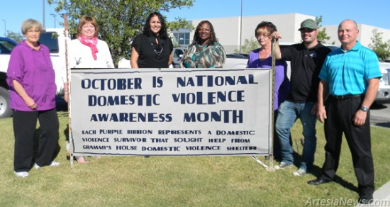 HollyFrontier Corporation shows full support of Grammy's House, Artesia's domestic violence shelter, by setting out a banner and purple ribbons representing victims of domestic violence in front of the business in the Blue Quail Shopping Center. Pictured are, from left, Sandi Lanning, Grammy's board of directors; HollyFrontier employee Pat Wood; Rosie Starrett; Grammy's Executive Director Celina Bryant; Joyce Lynch; Peyton Sterrett; and Dale Lynch, director of Finance/Accounting at HollyFrontier. Grace Miller – Daily Press