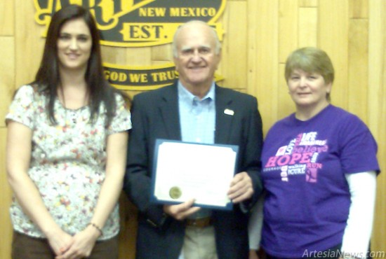 Mayor Phillip Burch, center, is joined by Brooke Carnathan, RN, left, and Carol Holland, CNP, of Yucca Healthcare Wednesday at City Hall as he declares October Breast Cancer Awareness Month in Artesia. Rebekah Melendez - Daily Press