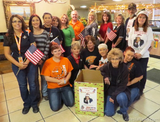 Pictured, representing Christmas for our Troops drop-off locations and sponsors, are, standing from left, Julie Sedillos of Zia Intermediate School, Michelle Madrid of Mack Energy, Helen Mariscal of Yucca Healthcare, Roxann Sallee of Yates Petroleum, Kathy Garrett of Concho Resources, Terry Maupin of Terry's Electronics, Lisa Thompson of Tate Branch Dodge, Kelcey McCaleb and Vickie Grousnick of the Artesia Chamber of Commerce, Jimi and Teresa Gensling of Christmas for our Troops, and kneeling from left, Pecos Diamond staff members Heather Davis, Brooke Barnett, Jilland Yandel, Lilli Smart, Ella Mae Stufft and Linda Kennedy. Grace Miller - Daily Press