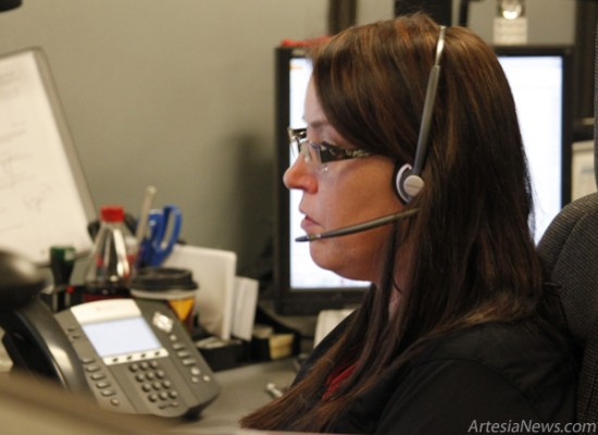 Bambi Kern, a REDA dispatcher for the past two years, takes a call in reference to diabetic complications during a tour of the dispatch center by Artesia High School students. Brandon Messick - Daily Press