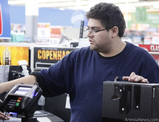 Wal-Mart employee Anthony Villareal scans the only Xbox One unit sold without preorder at midnight. Brandon Messick - Daily Press