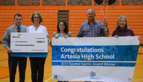 From left, Artesia High School Principal Scott Stall and AHS science teacher Melissa Burnett receive a check in the amount of $5,000 from Courtney Wardlaw, Jerry Mathews and Sherry Tabor of Devon Energy. Liana Swarengin - Daily Press
