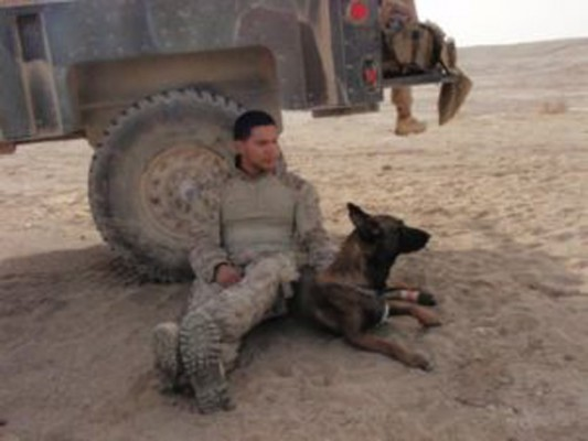 Pictured are Marine Adam and K-9 companion Rex. Courtesy Photo