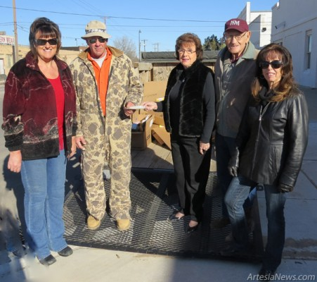 Pictured from left are Belinda Puckett of the B.P.O.E. Does, Jim Bly, passing off the last check of 2013 for $2,000 to Artesia Car Parts owners Jo and Ken Newton for their recycling efforts, and Linda Stevens of Artesia Clean & Beautiful, who organizes recycling efforts in Artesia. The total amount raised for the recycling year was  $3,500. Grace Miller – Daily Press
