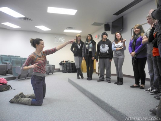 Above, Liz Reuss of The Second City touring group points to members of the AHS drama program during an improv exercise. At left, Jasbir Singh Vazquez participates in a skit during the troupe's performance Friday at the Ocotillo Performing Arts Center. Photo above by Liana Swarengin