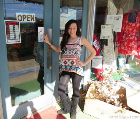 Taisha Perea affixes a Shop Local sticker to the window of a local business as the Artesia Chamber of Commerce and Artesia MainStreet gear up for Thursday's Light Up Artesia event and the Shop Local campaign. Grace Miller - Daily Press