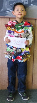 Marcos Calderon, a student in Jessica Martinez's Bee class at Grand Heights Early Childhood Center, marks the 100th day of school by sporting a shirt featuring 100 bowties. The Eager Beavers celebrated the day by wearing shirts featuring 100 of an item of their choosing.  Grace Miller – Daily Press