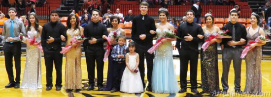 The 2014 Artesia High School Basketball Homecoming Court smiles for the crowd Saturday at Bulldog Pit. They are, from left, Junior Attendant Tiffany Cano, escorted by Jesse Miller; Senior Princess Marissa Fernandez, escorted by Christian Rodriguez; Senior Princess Shania Sheikh, escorted by Denzyl Garcia; crown bearer Ethan Conn and flower girl Evelyn Frescas; Homecoming Queen Anna Gonzales, escorted by Justin Houghtaling; Maid of Honor Ashley Boyce, escorted by Deion Wesson; and Sophomore Attendant Kayla Ledezma, escorted by Jonah Reza. Grace Miller - Daily Press