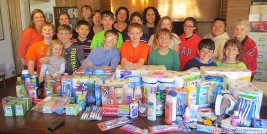 """The Cottonwood 4-H Club this week presented Grammy's House with a donation of emergency items. """"The community does so much for our kids, giving to Grammy's is the kids' way of giving back to the community,"""" said Casey Thalman of Cottonwood 4-H. """"Grammy's appreciates the Cottonwood 4-H Club for donating all these items,"""" said Grammy's Executive Director Celina Bryant. """"This is huge. These are items that would have to be purchased, and not having to buy these items now saves Grammy's money."""" Pictured above are, front row from left, TJ Thalman, Nathan Taylor, Brylin Taylor, JW Necaise, Zack Pinson, Dylan Goldston, Keegan Goldston, Jenna Goldston, center row from left, Jay Goldston, James Goldston, Ashley Sherrell, Christian Goldston, Alexis Bailey, back row from left, Jennifer Taylor, Julie Pinson, Brittany Necaise, Casey Thalman, Crystal Sanchez-Mancha, Celina Bryant, Monica Hatch, and Martha Speir.  Grace Miller – Daily Press"""