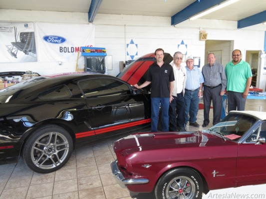 Robbie Burgess, Robert Burgess, Rick Coates, Bob Hendrickson and Raul Rodriguez pose with a 2014 Mustang Shelby GT and 1965 Mustang Convertible this morning as Artesia Ford Sales marked the 50th anniversary of the renowned muscle car.  Grace Miller - Daily Press
