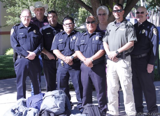 Brandon Messick – Daily Press Pictured from left are APD Cmdr. Lindell Smith, Drug and Crime Coalition Director Bob Johnson, Sgt. John Beasley, Cmdr. Emilio Olivas, Cmdr. Guy Chavarria, Drug and Crime Coalition Manager Nancy Husselman, Sgt. Chris Boor and Chief Don Raley.