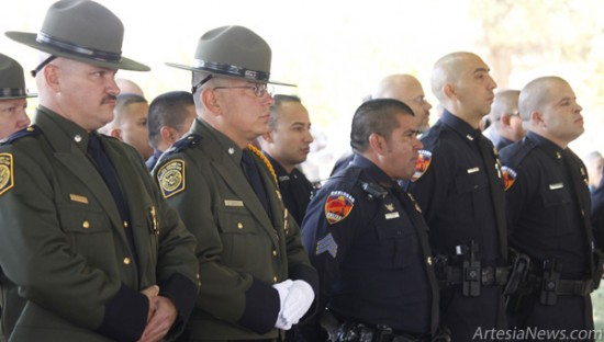 "Above, members of the New Mexico State Highway Patrol and the Carlsbad and Artesia Police Departments stand at attention in respect for fallen officers at the Law Enforcement Memorial and Awards Ceremony Wednesday in Carlsbad. Below, keynote speaker Susan Crockett of the Eddy County Commission speaks to the gathered officers. ""You're here to protect, serve and enforce the law, but you do so much more,"" Crockett said. Brandon Messick - Daily Press"