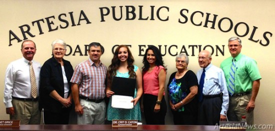 Alexis Aguirre, center, a 2014 graduate of Artesia High School, was recognized by the APSBoard of Education Monday for her Class 4A State Championship in the javelin, as well as for being an outstanding student. Aguirre broke the AHS record with her throw and was close to beating the state record, as well. Pictured from left are board members Jeff Bowman and Carolyn Shearman, head track coach Rex Henderson, Aguirre, her mother, Rebecca Chavaria, board members Margaret Aguilar and Lowell Irby, and Superintendent Dr. Crit Caton,   Liana Swarengin - Daily Press