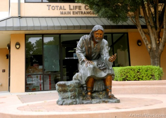 "A statue depicting Jesus is located in front of First Baptist Church's Total Life CEnter, known simply as ""Vision 2000"" in its early stages. By 2003, the facility was officially named and has been used to serve the community of Artesia over the past decade.  Liana Swarengin - Daily Press"
