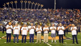 Members of the Artesia High School 1964 state championship football team are recognized at midfield during halftime of Friday's game against Carlsbad at Bulldog Bowl in honor of the 50th anniversary of the team's title. The '64 'Dogs, led by Coach L.G. Henderson, defeated Albuquerque Highland 20-6 in the state game.  Brienne Green - Daily Press