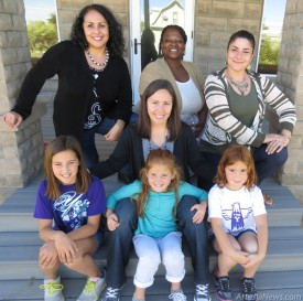 Bottom row from left, Elena Harvey, Vanessa Harvey with Carmen Harvey, and Adrienne Harvey are joined by Grammy's House staff, top row from left, Celina Bryant, Joyce Lloyd and Crystal Sanchez-Mancha. The Harveys were nominated by Grammy's for the New Mexico Coalition Against Domestic Violence Community Hero award.   Grace Miller – Daily Press