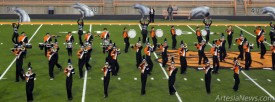 """The Artesia High School marching band performs its western-themed halftime show for the judges and public Tuesday evening at the annual Southeast New Mexico Music Educators Association District Marching Festival at Bulldog Bowl. The band's performance, which includes songs such as """"Bonanza"""" and """"Ghost Riders in the Sky,"""" earned them a top rating of 1. The AHS color guard also earned a 1 in competition at the band park.  Brienne Green - Daily Press"""