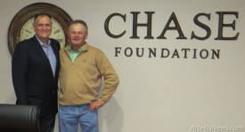 Chase Foundation Director Richard Price, right, stands with Dr. Jeffrey Boone during the grand opening of the Chase Foundation's new facility Thursday.  Grace Miller - Daily Press