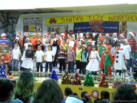 """First-graders from Roselawn Elementary School brought smiles to the faces of their parents and families Thursday as they performed their Christmas musical, """"Getting Ready for Christmas.""""The set list included """"Hip Hop Elves,"""" """"Let's Build a Gingerbread House,"""" """"Winter Wiggles"""" and """"Rock the Holly."""" Students were dressed as elves, reindeer, snowmen and poodle-skirt girls and used various props as they sang and danced.  Liana Swarengin - Daily Press"""