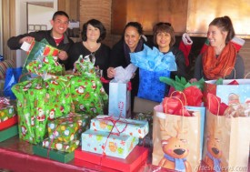 "From left, Marcos Contreras, Joanna Hall, Celina Bryant, Olga Fierro and Jamie Montoya pose with a selection of the gifts recently donated to Grammy's House by Concho Resources. It was Concho's fifth annual donation to the residents of the local domestic violence shelter. At left, Bryant poses with some of the presents that have been donated to Grammy's by various businesses and individuals. ""For those who are wondering how all the donations come to fruition,"" she said, ""the way this works is, the number of families in-house during this time each receive a number, and on Christmas Day, the families are brought in to find that number and their presents piled together, ready and waiting for Mom and the children to commence their very own traditional family celebration of Christmas.""  Grace Miller – Daily Press"