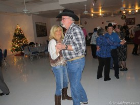 Artesia City Clerk Aubrey Hobson dances with fiancee Angie Russell Wednesday during a New Year's Eve party at the Senior Center. Hobson proposed on Christmas, the couple is looking to plan a Valentine's Day wedding. Celebrations were held throughout the community despite the frigid weather as Artesians bid farewell to 2014 and ushered in the new year.   Grace Miller - Daily Press