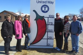 Members of the North Eddy County United Way Board of Directors, from left, Sheila Fisher, Julie Gibson, Shannon Johnson, David Grousnick, Leah Boone and David Taylor, pose with the fully red chile signifying the organization has met its fundraising goal for 2015 and will be able to assist a total of 15 local organizations with funding.  Grace Miller – Daily Press