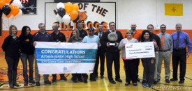Artesia Public Schools Superintendent Dr. Crit Caton, far right, members of the Park Junior High science staff, Park Principal Cody Skinner, eighth from right, Devon Energy Senior Production Superintendent Jerry Matthews, fourth from left, Devon Community Relations Specialist Shannon Johnson, far left, and Devon Energy staff stand midcourt this morning at Park Junior High at a special assembly during which Devon announced to the students the school would be receiving a $35,000 award for excellence in science education, the first-place prize in a grant competition. Eighth-grade science teacher Ashley Mason, sixth from right, completed the grant and says the funds will be put toward LearnPad tablets for all science classes that will give students hands-on access to virtual labs.  Teresa Lemon - Daily Press