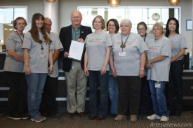 "From left, Artesia Public Library staff members Mary Finney, Wendy Kilpatrick, Omar Acosta, Supervisor Laura Mischke Simon, Jo Scott, Peggy Swafford, Geri Dosalua, Debra Laman and Michelle S. Martinez join Mayor Phillip Burch as he declares the month of March 2015 as MARCHiversary in Artesia in celebration of the library's one-year anniversary. According to the proclamation, libraries are a part of the American dream, as they are places for opportunity, education, self-help and lifelong learning. ""The APL is the heart of the community and provides it with a wide range of resources from traditional book lending to free broadband access and community classes,"" the proclamation states. The citizens of Artesia are using the new library in record numbers. Burch encourages residents to visit the APL and take advantage of the many programs and events in this month-long celebration.  Ben Theobald – Daily Press"