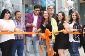 "Kouros & Kore Kouros & Kore owner Arturo Casillas cuts the ribbon at the local shop's grand reopening Saturday as, from left, Melissa Talavera, Boo Boo Chavarria, Martha Chavarria, David Grousnick, Michelle Casillas and Kristen Juarez look on. Kouros & Kore, a women's apparel and accessories boutique, is now located at 325 W. Main St. Apparel sizes range from small to 3X, and the shop is working to add men's graphic tees. ""Our goal in the store is to bring the best quality products to exceed customers' expectations at prices that are reasonable,"" Casillas said. ""We bring only a small amount of each style so that not everyone in this small town owns the same thing. We constantly receive new styles, and we stay on top of what's trending to offer the latest fashion to Artesia from Los Angeles. We plan on expanding our product lines so that we have something to offer to everyone!"" Kouros & Kore is open from 11 a.m. – 6 p.m. Tuesday-Friday and 11 a.m. – 4 p.m. Saturdays.  Ben Theobald – Daily Press"