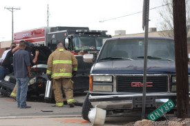 Authorities work the scene of a two-vehicle accident that occurred Tuesday afternoon at 12th Street and Grand Avenue. According to an Artesia Police Department officer on the scene, a GMC 1500 truck was at a stop sign heading southbound on 12th Street when the driver pulled out into the intersection and struck the front end of a Volkswagen Jetta travelling eastbound on Grand Avenue. The driver of the Jetta was taken to Artesia General Hospital with complaints of neck pains; the driver of the GMC was not injured. Both vehicles sustained front-end damage and were towed from the scene. There was also damage to a stop sign and a utility pole, which required repairs by Xcel Energy. The driver of the GMC was cited for traffic violations.  Ben Theobald – Daily Press