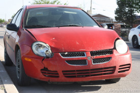 A red Dodge Neon, pictured above, sustained significant damage Monday morning when it was struck at the intersection of 10th Street and Gilchrist Avenue. The accident occurred when the driver of a silver Ford SUV heading east at the intersection of 10th and Gilchrist failed to see the Neon travelling south on 10th Street and struck it. The fan in the Neon was damaged to the point it had to be towed from the scene. The SUV sustained some damage but was still mobile. No injuries were reported.  Ben Theobald – Daily Press