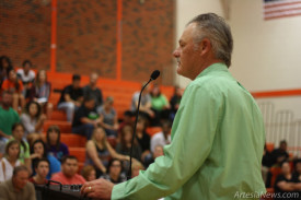 Above, Richard Price, execute director of the Chase Foundation, speaks to students and parents Thursday evening at the Artesia High School old boys' gym about scholarship opportunities available to the Class of 2015 through the Chase Scholarship program. Price said about 110 scholarship awards are available totaling an estimated $1.5 million. Students and parents can go online to the Chase Foundation's website to fill out and submit an application. Students must have at least a 3.0 GPA and be in their fourth year at AHS to qualify. The deadline to apply is Thursday, April 30. The Chase Scholarship program is in its ninth year and has awarded more than $9 million dollars in scholarship funds to AHS graduates.  Ben Theobald – Daily Press
