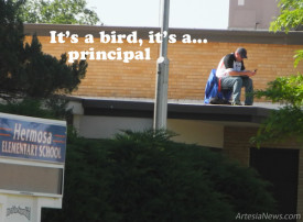 """Mike Worley, principal at Hermosa Elementary School, settles in this morning for a long day perched atop the roof of his school building. Worley challenged his student body to raise $12,000 in last fall's Spirit Run, and they met that challenge head on, raising more than $15,000. So, true to his word, Worley is """"showing the kids that I was not afraid of doing something difficult as well."""" He added it is also his way of showing students """"how proud he is of them and their performance throughout not only the school year but especially during the PARCC testing."""" Armed with a chair, a cell phone, a laptop, and some sunscreen, Worley will remain on the roof until school dismisses this afternoon.  Teresa Lemon – Daily Press"""