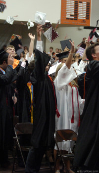 "Above, members of the Artesia High School Class of 2015 toss their caps in the air Thursday during commencement exercises at Bulldog Pit. As is popular with graduating classes, each student handed something to the administrators distributing their diplomas, but rather than a marble or piece of candy, AHS Principal Scotty Stall reports, the 208 students presented money to be donated to the Marquise' Weast Memorial Scholarship Fund. A total of $1,456 was collected in this way, with no prior knowledge or guidance from the administration or AHS staff. ""I couldn't be more proud of these young  people,"" Stall said. See Page 5 for additional graduation photos and inside for the Daily Press' annual Graduation Special and Scholarship Edition."