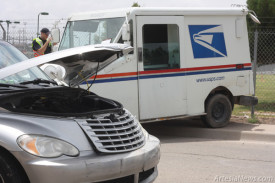 A U.S. Postal Service delivery vehicle sits half on the sidewalk on 10th Street Tuesday following an accident that took place in the area of 10th and Richey Avenue. According to Artesia Police Department Cmdr. Lindell Smith, the wreck occurred when a Chrysler PT Cruiser struck the mail vehicle. Two people were transported to Artesia General Hospital but sustained no visible injuries. The driver of the PT Cruiser was cited for careless driving and no insurance.  Ben Theobald – Daily Press