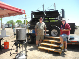 """BSGrilling, comprised of Bill Taylor, left, of Albuquerque and Steve Wilson of Rio Rancho await meat inspection this morning at the Eddy County Fairgrounds as they prepare to begin cooking in the Fourth Annual Smokin' on the Pecos New Mexico State BBQChampionship. BSGrilling, whose motto is """"Alittle BS goes a long way,"""" has been competing in barbecue cook-offs for 15 years and considers pulled pork its specialty. The duo took fourth place in ribs at last year's SOTP and have won in several categories over the years but never the whole hog, so to speak. Wilson will be returning to Artesia in the fall for the Balloons and Tunes Festival to pilot the SOTP hot air balloon. Judging begins at noon Saturday in the professional barbecue competition.  Teresa Lemon - Daily Press"""
