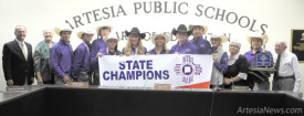 Members of the APS Board of Education pose with the state champion Artesia High School rodeo team Monday at the Administration Building. Pictured from left are Jeff Bowman, Carolyn Shearman, Morgan Brown, Blaise Milligan, Payson Hendrix, Kaitlyn Harwell, Maddy Deerman, coach Kerrie Pitts, Bryce McCormick, Jon Solt, Kenna Sullivan, senior and New Mexico High School Rodeo student body president, Leann Herring, senior, Margaret Aguilar and Lowell Irby. Teresa Lemon – Daily Press
