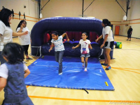 "Children in the City of Artesia's youth recreation program enjoy an inflatable obstacle course Friday morning at the Artesia Center. This year's program has a ""Space Odyssey"" theme, and Recreation Supervisor Luis Reyes reports he and his summer staff of 35 are currently overseeing 180 youths. The program runs from 8 a.m. – noon, Monday through Friday, through July 24 and is available to children ages 6 and up. The fee is $50 per child and includes a t-shirt, dance and prizes. Activities include games, arts and crafts, and exploring the space recreation theme.  Teresa Lemon – Daily Press"